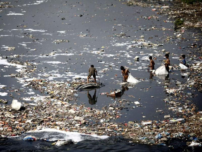 Children look for plastic bottles at the polluted Bagmati River in Kathmandu. (Reuters)