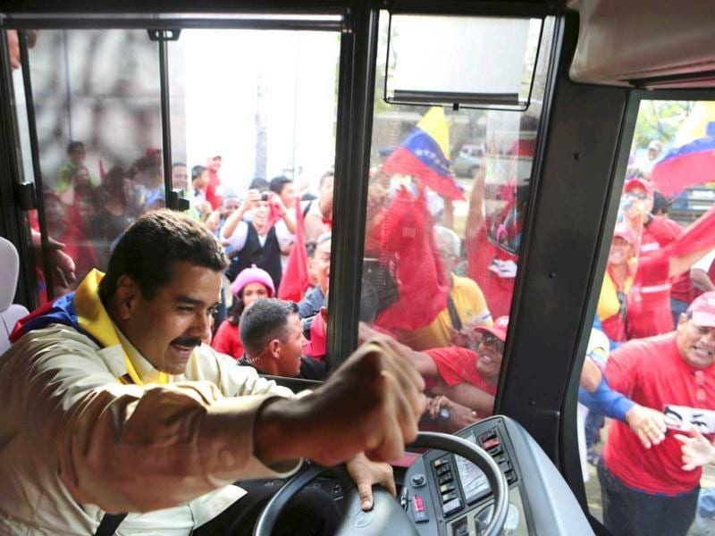 Venezuela's acting President and former bus driver Nicolas Maduro drives a vehicle during a visit to the state of Zulia. (Reuters)