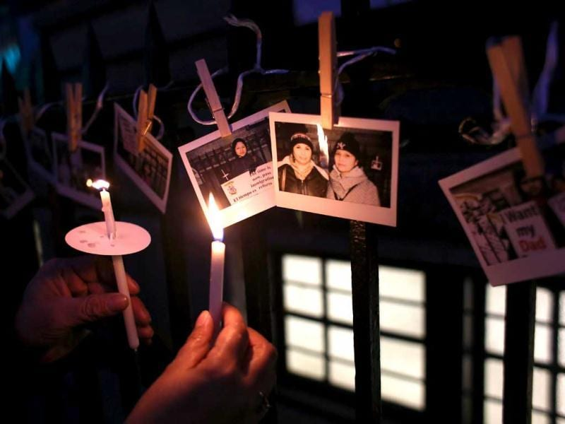 Immigrants from Colombia and Ecuador hold a candlelight vigil, showing photos of supporters for immigration reform in New York City. (AFP)