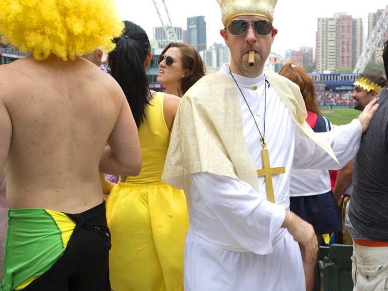 A rugby fan wearing a priest costume looks on at the spectators' stand during the second day of the three-day Hong Kong Sevens rugby tournament. Reuters photo