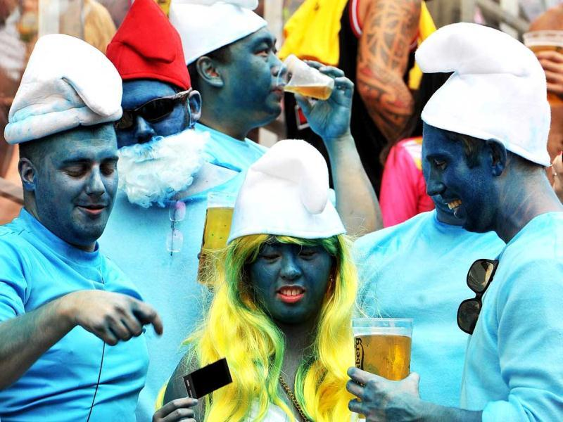 Fans dressed in fancy costume attend the second day of the Hong Kong Rugby Sevens tournament. AFP photo
