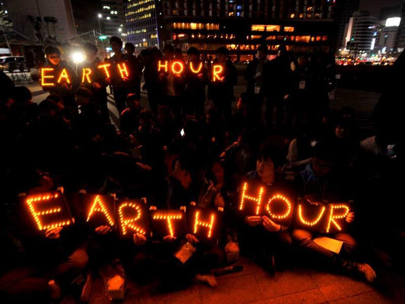 South Korean students hold Earth Hour LED displays during the 7th annual Earth Hour global warming campaign in Seoul. AFP
