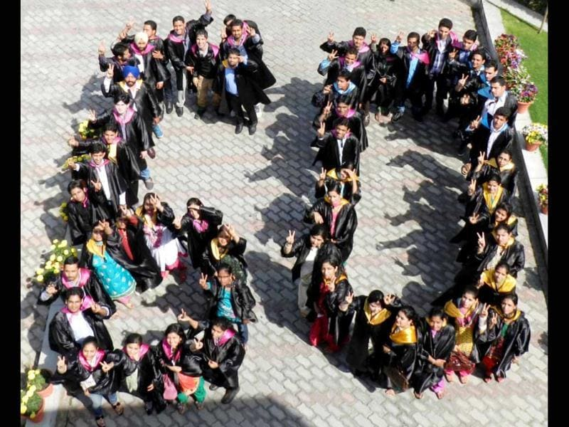 Students at Chandigarh's Aryans campus form the figure of 60 during their convocation to support Earth Hour. UNI