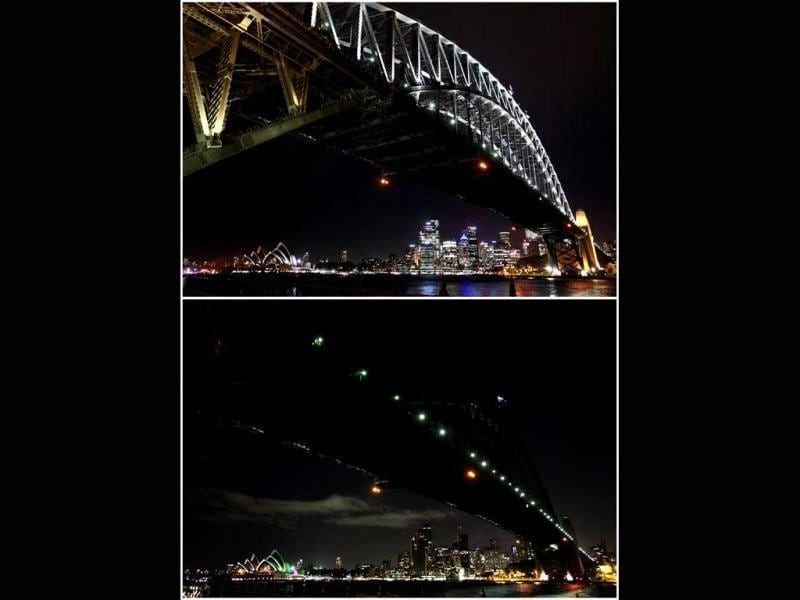 A combination picture shows the Sydney Harbour Bridge and city skyline (top) before Earth Hour, and during Earth Hour. Reuters