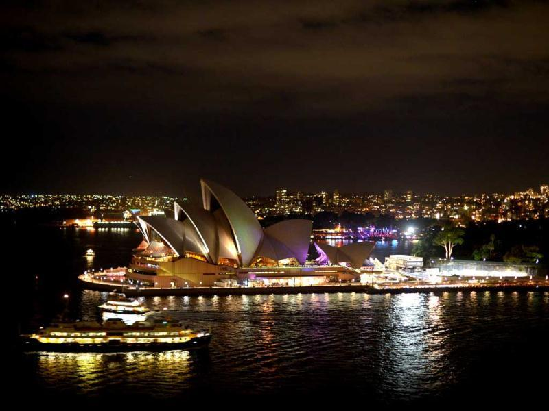 The Sydney Opera House illuminated shortly before the start of the annual Earth Hour. AFP