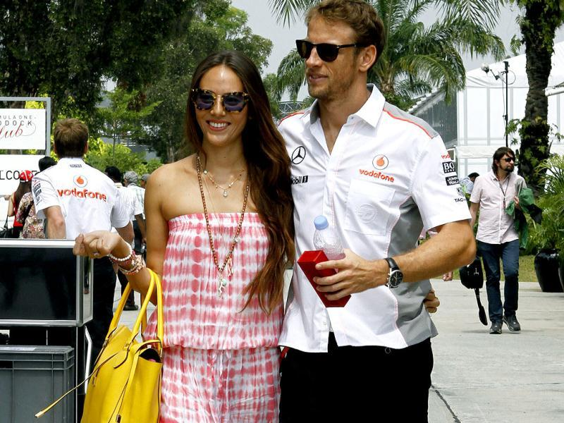 McLaren driver Jenson Button of Britain, right, and his girlfriend Jessica Michibata arrive at the Malaysian Formula One Grand Prix in Sepang, Malaysia. AP Photo