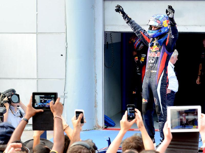 Red Bull driver Sebastian Vettel of Germany celebrates his victory in the Formula One Malaysian Grand Prix in Sepang. AFP photo