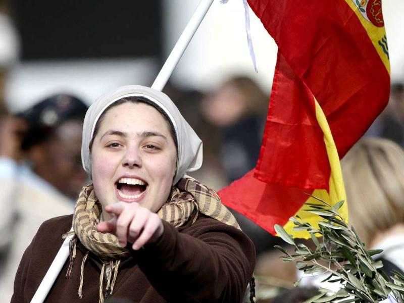 A Spanish nun shouts during the Palm Sunday mass led by Pope Francis at Saint Peter's Square at the Vatican. Reuters