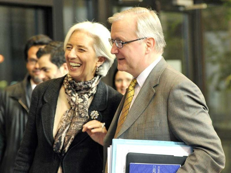 EU commissioner for economic and monetary affairs Olli Rehn (R) and International Monetary Fund (IMF) managing director Christine Lagarde (L) leave following a Eurozone meeting at EU headquarters in Brussels. AFP photo