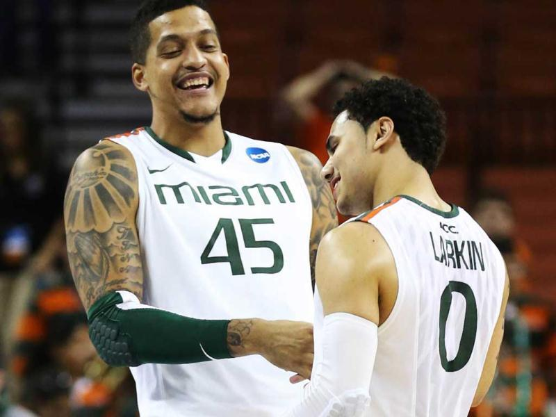 Shane Larkin celebrates with Julian Gamble of the Miami Hurricanes after their win over the Illinois Fighting Illini during the third round of the 2013 NCAA Men's Basketball Tournament at The Frank Erwin Center in Austin, Texas. AFP