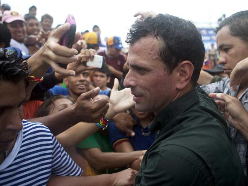 Venezuela's opposition candidate Henrique Capriles greets supporters during a campaign rally in San Felipe, in the state of Yaracuy. Reuters