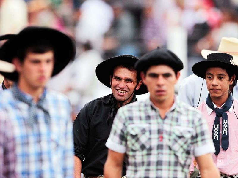 Gauchos leave the field after participating during the annual celebration of Criolla Week in Montevideo. REUTERS