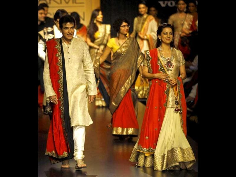 Jeetendra, left, and Juhi Chawla display creations by Vikram Phadnis during the Lakme Fashion Week in Mumbai, India. (AP Photo)