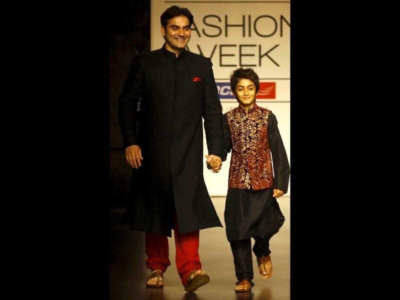 Arbaaz Khan, left, and his son Arhaan Khan display creations by Vikram Phadnis during the Lakme Fashion Week in Mumbai, India. (AP Photo)