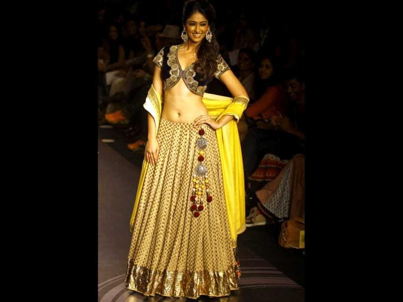 Ileana D'Cruz displays a creation by Vikram Phadnis during the Lakme Fashion Week in Mumbai, India. (AP Photo)