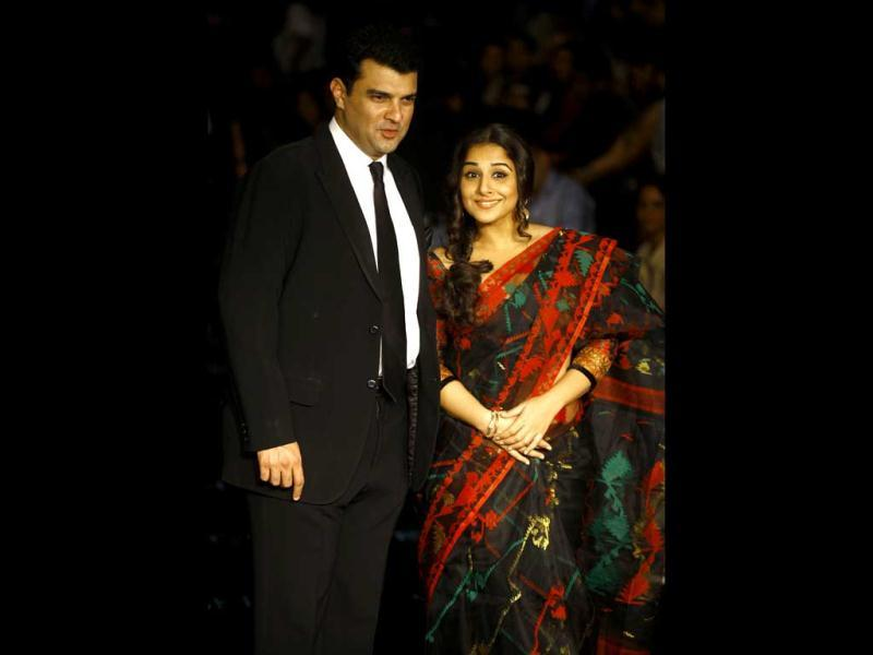 Vidya Balan attends the Lakme Fashion Week with her husband Siddharth Roy Kapur in Mumbai, India. (AP Photo)