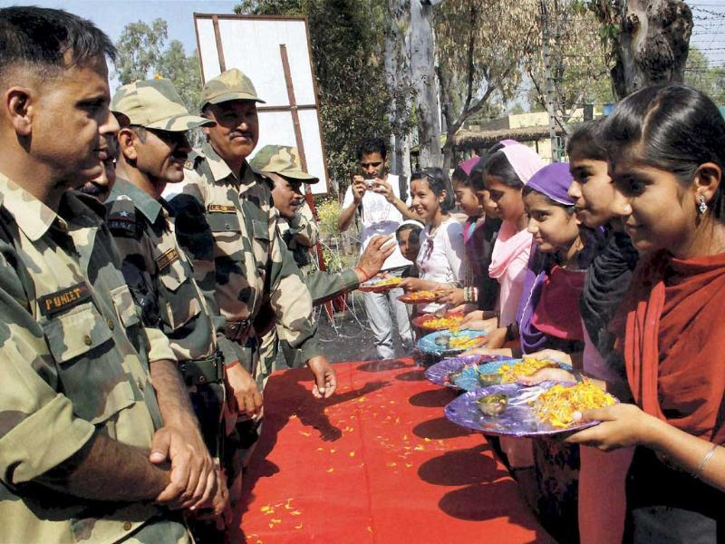 Border Security Force (BSF) jawans celebrate Holi festival at India-Pakistan border of Suchetgarh near Jammu.PTI