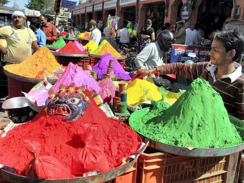 A vendor selling Holi colours ahead of Holi festival, in Jaipur. PTI