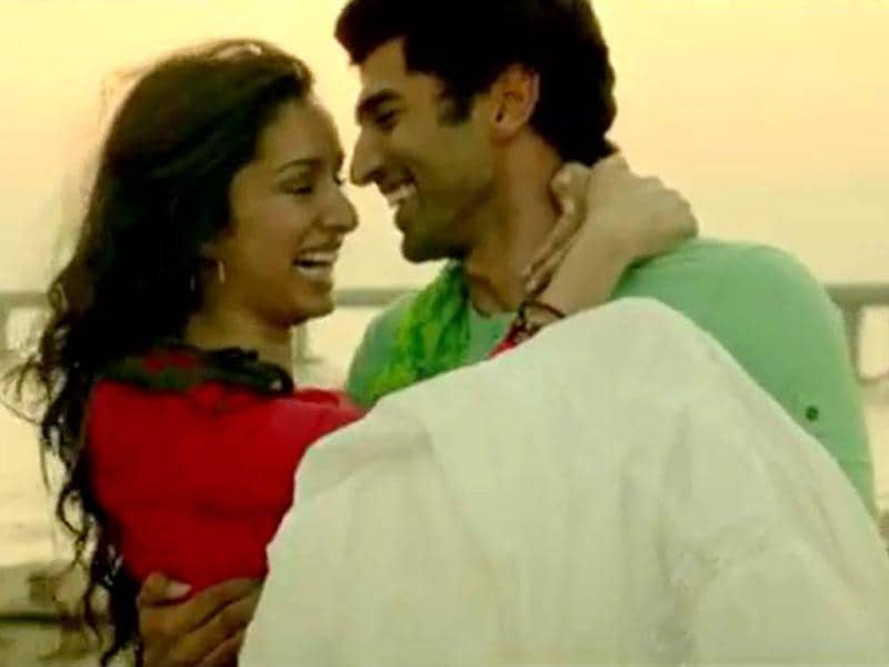 Shraddha Kapoor and Aditya Roy Kapoor share a light moment in a still from Aashiqui 2.