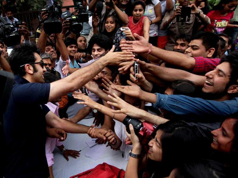 Ranbir Kapoor shakes hands with his fans during a charity football match in New Delhi on Thursday. PTI Photo