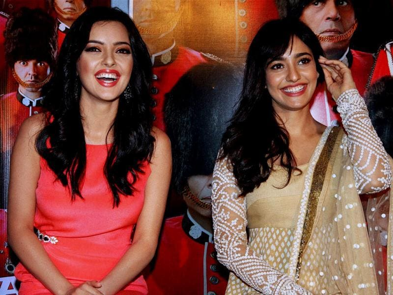 Neha Sharma and Kristina Akheeva at the launch of the first look of their upcoming film Yamla Pagla Deewana 2 in Mumbai on Thursday. (PTI PHOTO)