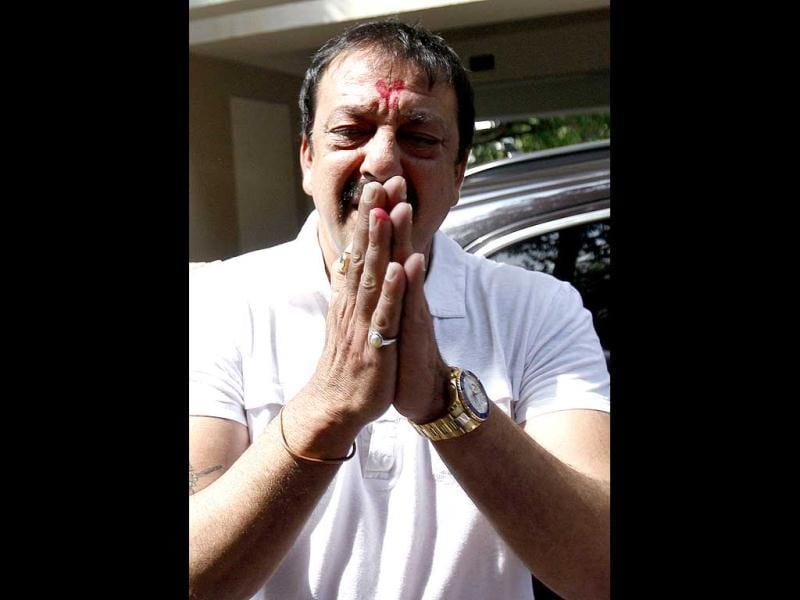 Sanjay Dutt, gestures to journalists during a press conference at his residence in Mumbai, India. Dutt said he has not sought pardon for a 1993 weapons conviction and will serve his prison sentence as ordered by India's Supreme Court. (AP Photo)