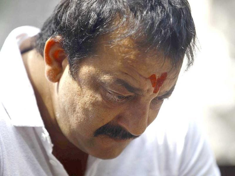 Sanjay Dutt, looks down during a press conference at his residence in Mumbai. Dutt broke his silence a week after the court sentenced him to five years in prison for illegal possession of weapons supplied by Mumbai crime bosses linked to a 1993 terror attack that killed 257 people.(AP Photo)