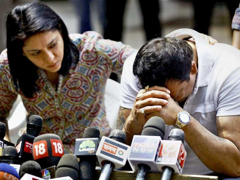Sanjay Dutt, convicted in 1993 Mumbai blast case, breaks down as his sister Priya Dutt tries to console him during a press conference at his residence in Mumbai. (PTI Photo)