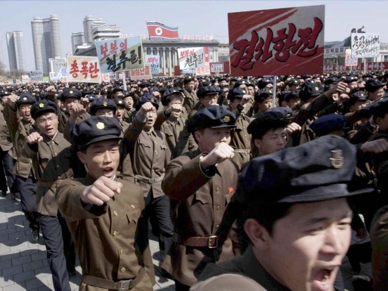 North Koreans punch the air during a rally at Kim Il Sung Square in downtown Pyongyang, North Korea. Tens of thousands of North Koreans turned out for the mass rally at the main square in Pyongyang in support of their leader Kim Jong Un's call to arms. (AP Photo)