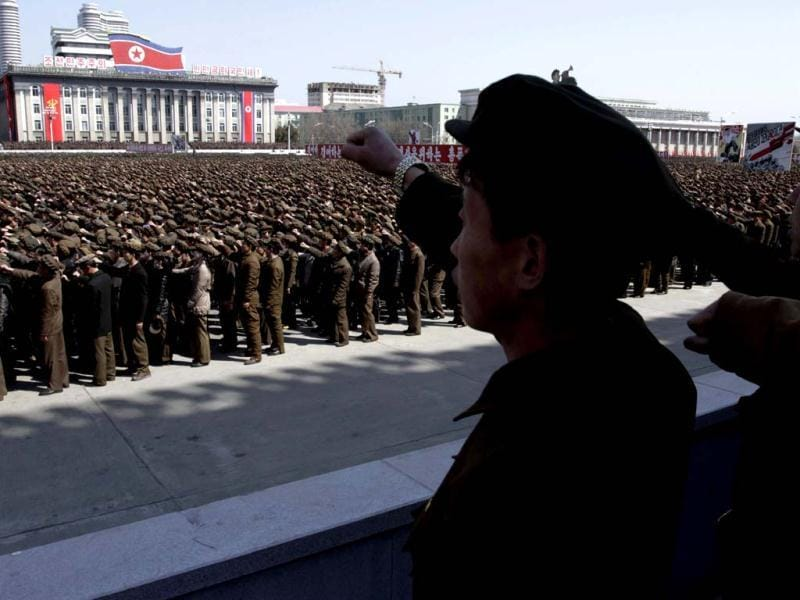 North Koreans gather for a rally at Kim Il Sung Square in downtown Pyongyang, North Korea. Tens of thousands of North Koreans turned out for the mass rally at the main square in Pyongyang in support of their leader Kim Jong Un's call to arms. (AP Photo)