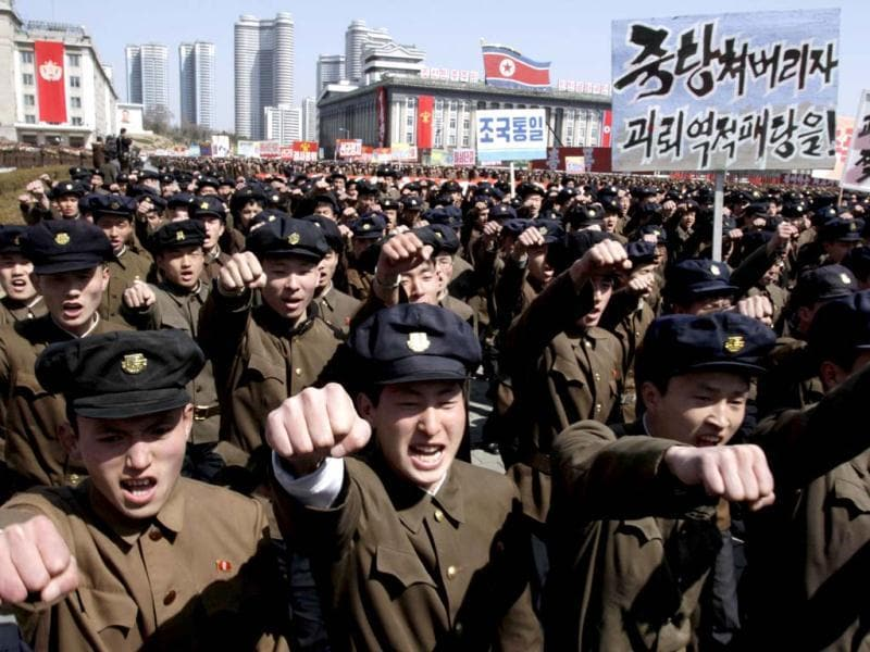 North Korean army officers punch the air during a rally at Kim Il Sung Square in downtown Pyongyang, North Korea. Tens of thousands of North Koreans turned out for the mass rally at the main square in Pyongyang in support of their leader Kim Jong Un's call to arms. (AP Photo)