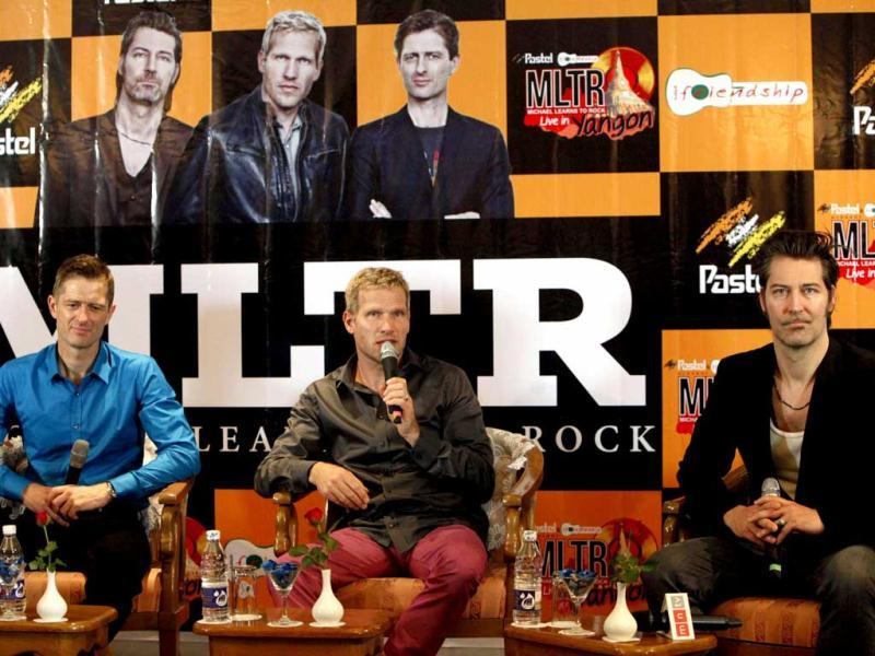 Rock band Michael Learns to Rock (MLTR) members, from left, Kare Wanscher, Jascha Richter and ikkel Lentz, speak during a press conference ahead of their March 31 concert, in Yangon, Myanmar. (AP Photo)