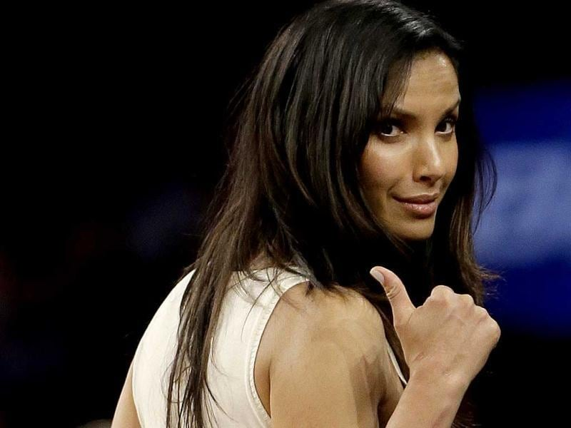 Television's 'Top Chef' host Padma Lakshmi gestures during the second half of an NBA basketball game between the New York Knicks and the Charlotte Bobcats in New York. (AP Photo)