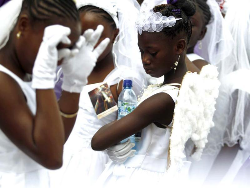 Girls from the Garifuna ethnic people are dressed in white while participating in a procession to mark the death of Jesus Christ on Good Friday during Holy Week in Livingston. (Reuters)