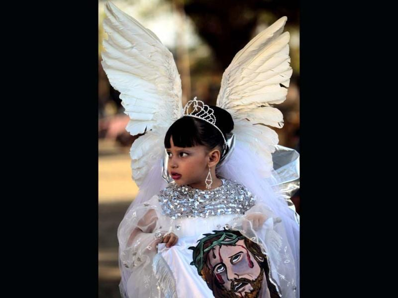 A girl dressed as an angel takes part in a Good Friday procession in Masaya city. (Reuters)