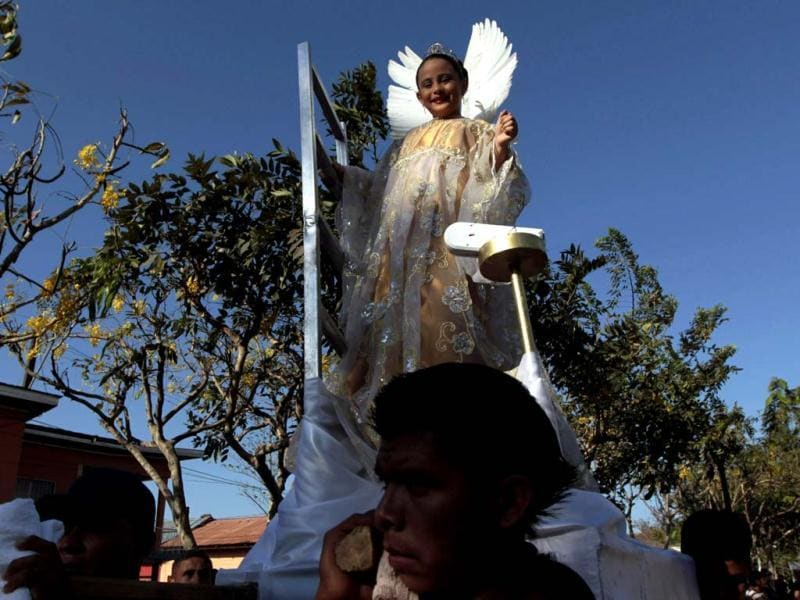 A girl dressed as an angel takes part in a Good Friday procession in Masaya. (Reuters)