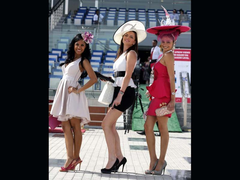 Guests pose for a photograph as others arrive at the Meydan race track before the start of the Dubai World Cup. (AFP)