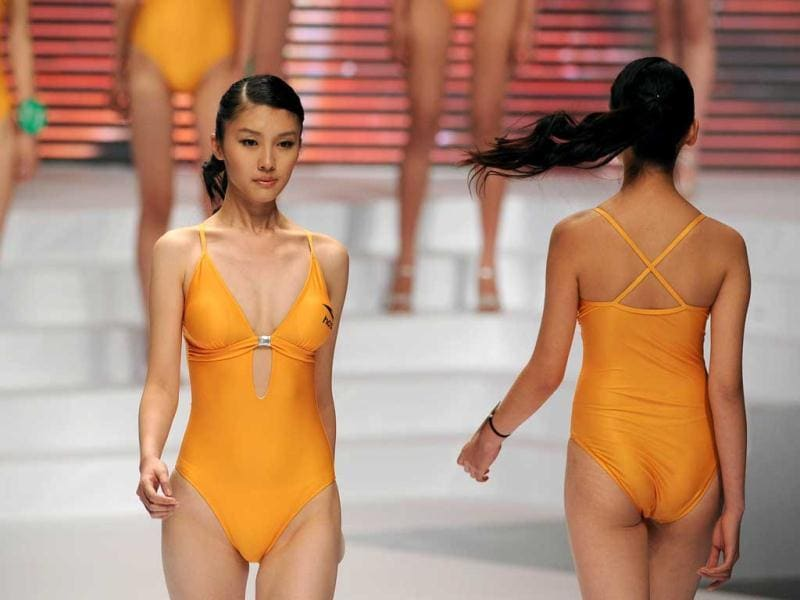 This picture taken shows models showcasing swimsuits during the China Super Model Final as part of the China Fashion Week in Beijing. (AFP Photo)