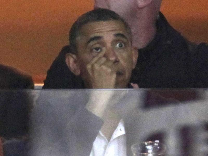President Obama watches NCAA basketball game in Washington. (Reuters)