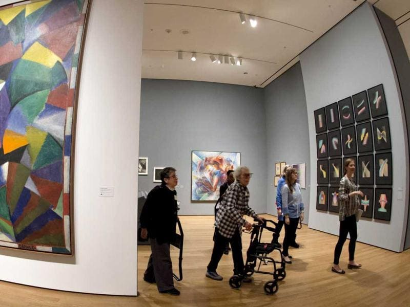 A small group with various levels of impaired vision tour an exhibit called Inventing Abstraction at the Museum of Modern Art in New York. (AFP Photo)