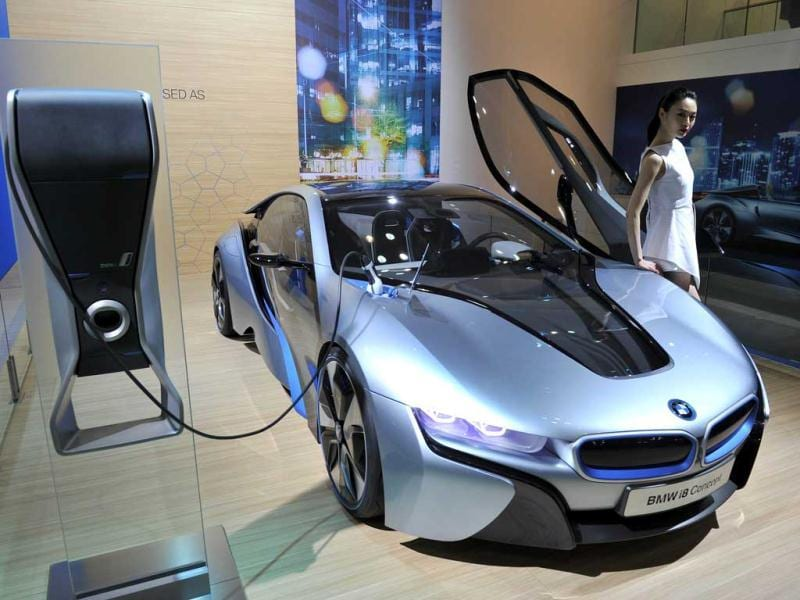 South Korean model poses with BMW i8 Concept during a press preview of the Seoul Motor Show in Goyang, north of Seoul. (AFP Photo)