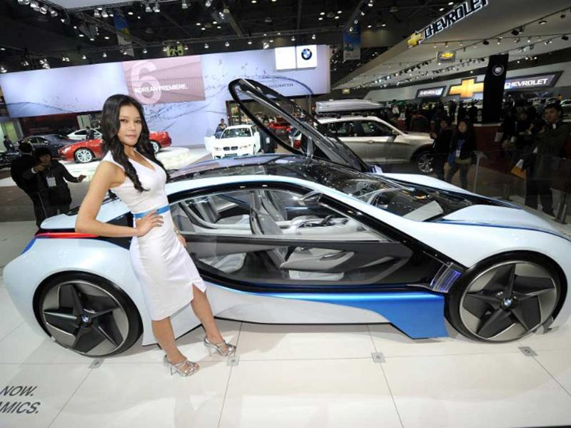 A South Korean model poses with a BMW concept car during a press preview of the Seoul Motor Show in Goyang, north of Seoul. (AFP Photo)