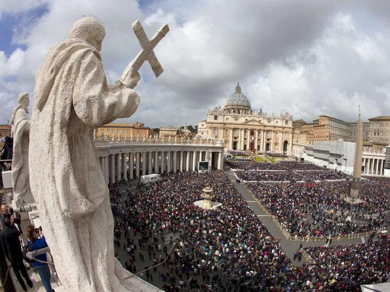 Thousands of devotees gather at St Peter's Square in Vatican City to celebrate Easter Sunday. AP