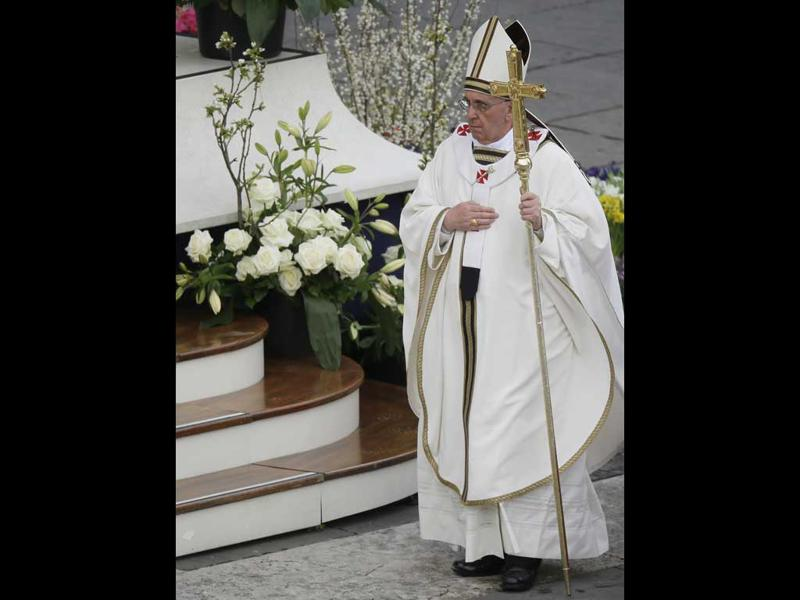 Pope Francis walks with the pastoral staff as he celebrates the Easter mass in St. Peter's Square at the Vatican. AP