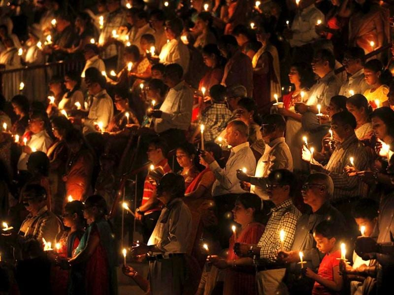 Christians hold candles as they offer prayers to celebrate Easter outside a church in Ahmedabad. Reuters