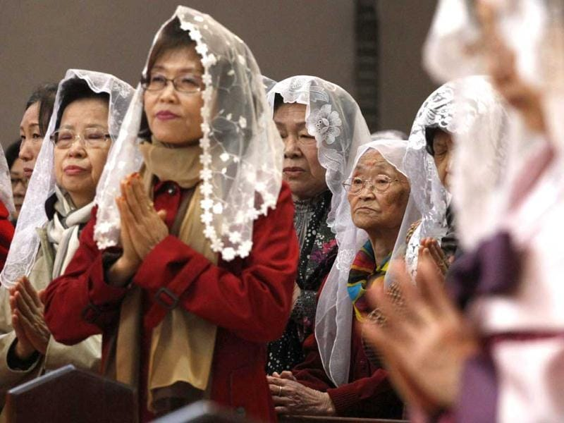South Korean Catholics pray for peace on the Korean Peninsula during an annual Easter service at Myeongdong Catholic Cathedral in Seoul. AP