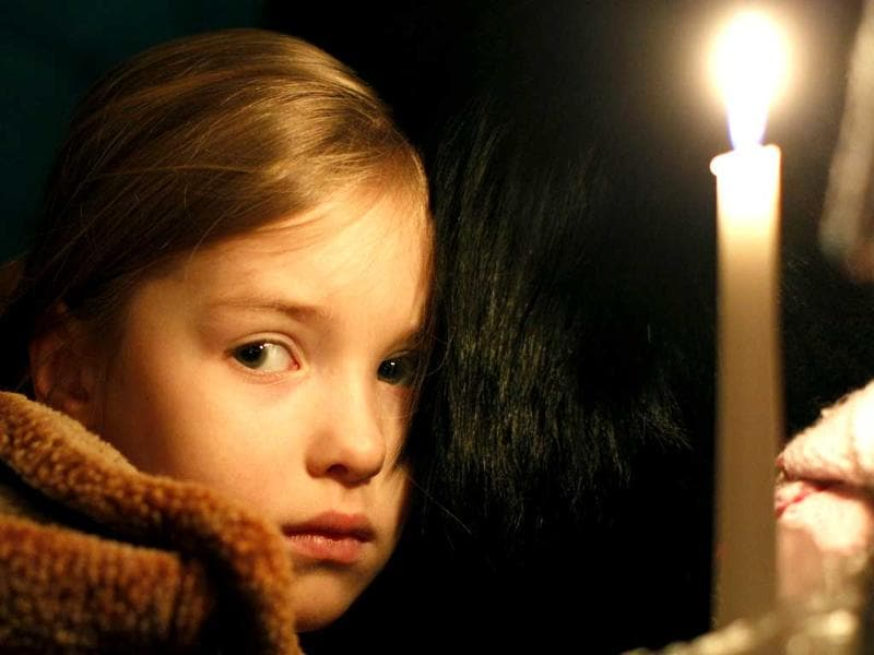 A young girl attends an Easter vigil mass at Cathedral-Basilica in Vilnius, Lithuania. AP