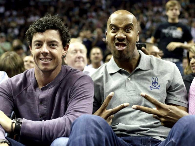 Rory McIlroy and former San Antonio Spurs forward Bruce Bowen, pose for a photo during the second half of an NBA basketball game between the San Antonio Spurs and Miami Heat in San Antonio. Miami won 88-86. (AP)