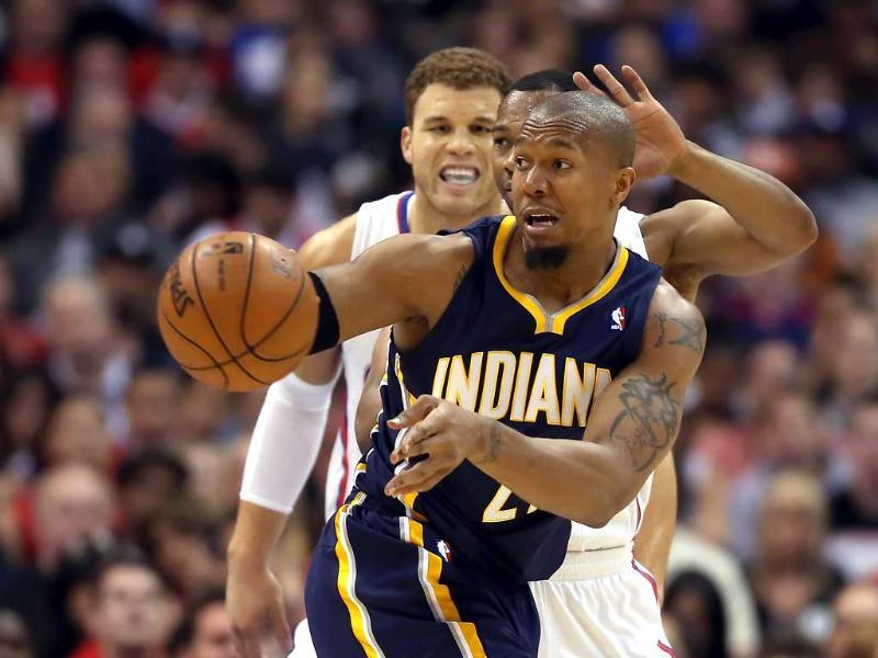 David West of the Indiana Pacers passes the ball while defended by Willie Green and Blake Griffin of the Los Angeles Clippers in the first half at Staples Center in Los Angeles, California. AFP