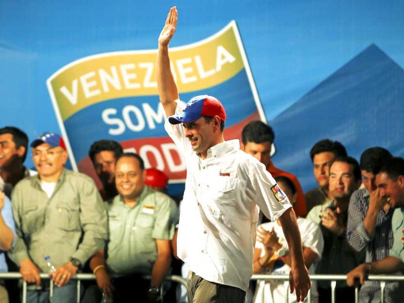 Venezuela's opposition leader and presidential candidate Henrique Capriles waves to supporters during a campaign rally in Caracas. Reuters